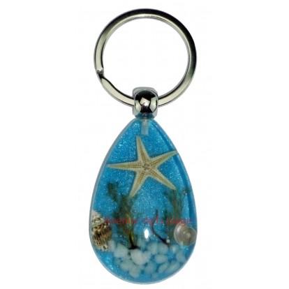 Porte clefs bleu avec véritable étoile de mer.