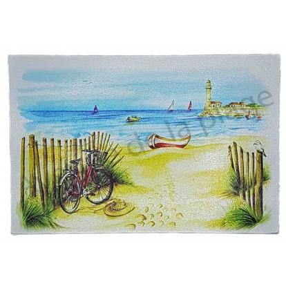 Planche à découper vélo rouge à la plage