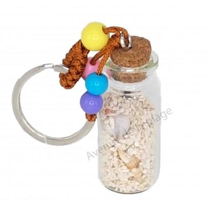 Porte clé bouteille de sable et coquillages