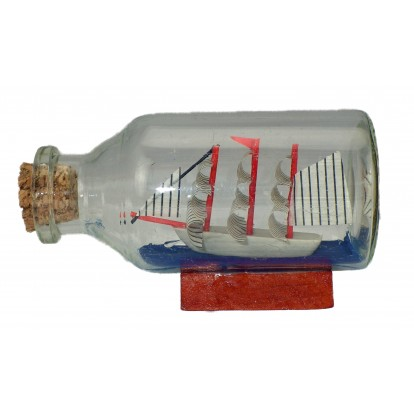 Maquette voilier dans une bouteille en verre 7 cm.