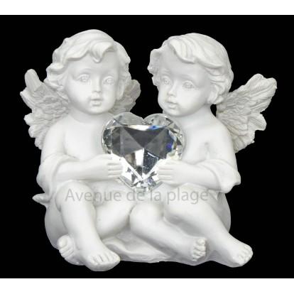 Figurine anges avec coeur brillant
