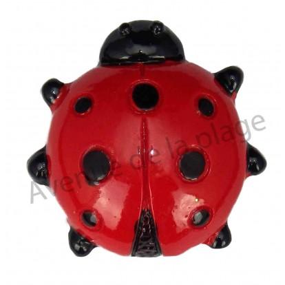 Magnet coccinelle rouge et noire.