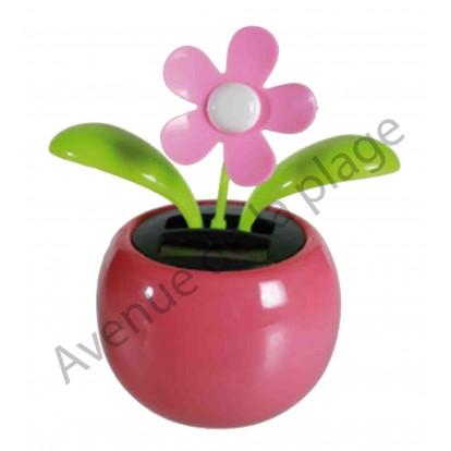 Fleur rose solaire qui se balance, pot rose B