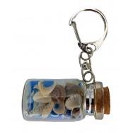 Porte clés bouteille avec sable bleu et coquillages