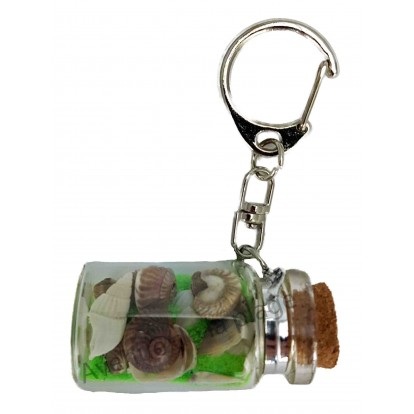Porte clefs bouteille avec sable vert et coquillages
