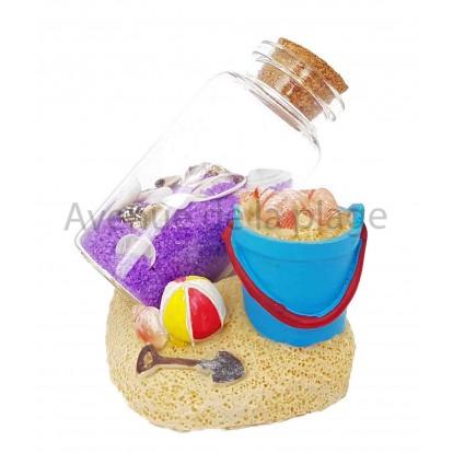 Seau de plage avec bouteille de sable