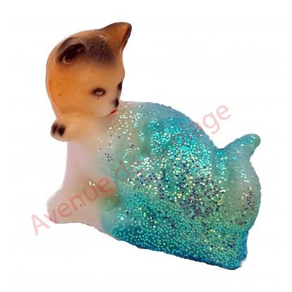 Sujet météo chat faisant sa toilette, bleu par beau temps.
