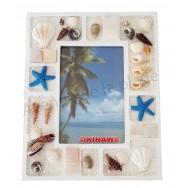 Cadre photo coquillages et sable blanc