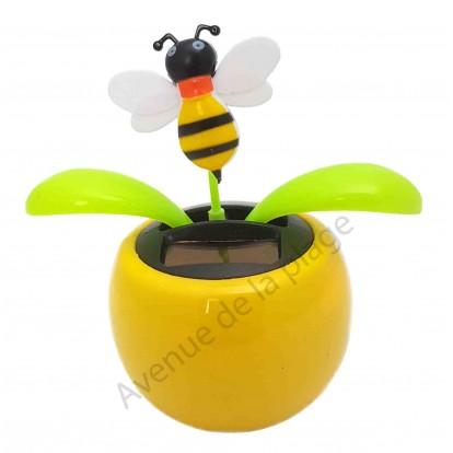 Plante solaire avec abeille qui se balance D